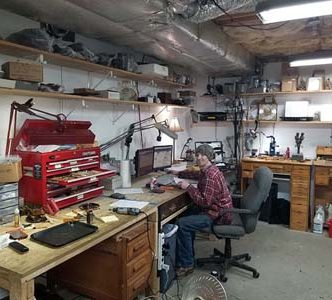 Clockmaker Robert Turgeon emailing a customer