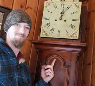 Clockmaker Robert Turgeon finishing an original Willard tall case